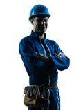 Retrato amistoso sonriente de la silueta del trabajador de construcción del hombre Fotos de archivo libres de regalías