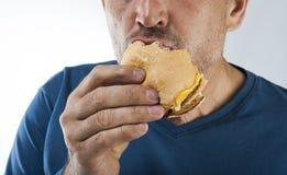 Retrato antropófago de la hamburguesa del vago feo Fotografía de archivo