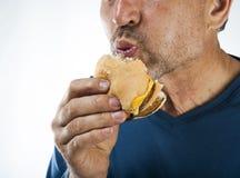 Retrato antropófago de la hamburguesa del vago feo Imágenes de archivo libres de regalías