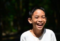 Retrato asiático de la risa del muchacho Fotos de archivo