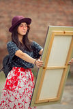 Retrato asiático joven de la mujer con la pintura Imagen de archivo