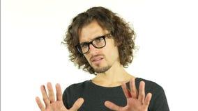 Retrato asqueado, rechazando oferta, gesto de Isloated de no del hombre joven almacen de video