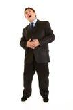 Retrato cheio do comprimento de rir o homem de negócios novo fotografia de stock