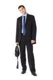 Retrato cheio do comprimento de um homem de negócios novo Foto de Stock Royalty Free