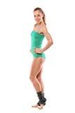 Retrato cheio do comprimento de um levantamento da mulher do atleta Fotos de Stock