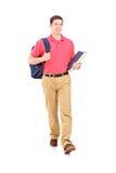 Retrato cheio do comprimento de um passeio do estudante masculino Foto de Stock