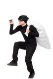Retrato cheio do comprimento de um salteador com um saco Fotografia de Stock
