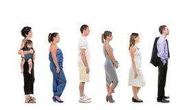 Retrato cheio do comprimento dos povos em uma linha Fotos de Stock Royalty Free