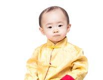 Retrato chino del bebé con el traje tradicional Fotos de archivo libres de regalías