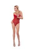 Retrato completo do comprimento da mulher loura bonita nova no levantamento vermelho do roupa interior isolada sobre o fundo bran Imagem de Stock Royalty Free