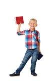 Retrato completo do comprimento de rir o menino novo com os livros isolados no fundo branco Educação foto de stock royalty free
