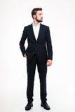 Retrato completo do comprimento de um homem de negócios seguro que olha afastado imagem de stock royalty free