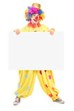 Retrato completo do comprimento de um palhaço masculino com o expressio alegre feliz Fotos de Stock