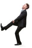Retrato completo do comprimento do ajuste do homem de negócios contra algo Imagens de Stock Royalty Free