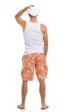 Retrato completo do comprimento do homem nos shorts e no chapéu foto de stock