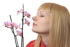 Retrato con la orquídea Imágenes de archivo libres de regalías