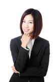 Retrato confidente hermoso de la sonrisa de la mujer de negocios Imagen de archivo libre de regalías