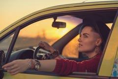 Retrato creativo en coche Imágenes de archivo libres de regalías