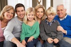Retrato da família de três gerações em casa Fotografia de Stock Royalty Free