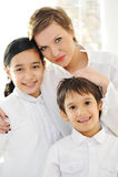 Retrato da filha e do filho felizes da mãe Imagem de Stock Royalty Free