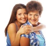 Retrato da filha que abraça sua mãe Fotos de Stock Royalty Free