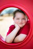 Retrato da jovem criança no campo de jogos fotografia de stock royalty free