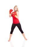Retrato da jovem mulher bonita que faz o exercício do encaixotamento Foto de Stock Royalty Free