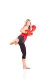 Retrato da jovem mulher bonita que faz o exercício do encaixotamento Imagem de Stock