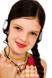 Retrato da música de escuta da menina Imagem de Stock