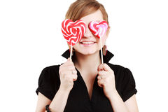 Retrato da menina bonita com lollipop grande fotografia de stock