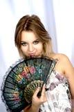 Retrato da menina com um ventilador Imagem de Stock Royalty Free