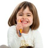Menina feliz com pastéis. imagem de stock