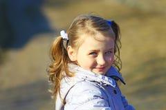 Retrato da moça com tranças agradáveis Imagens de Stock Royalty Free