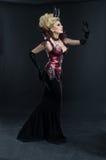 Retrato da mulher bonita do diabo no vestido 'sexy' escuro imagens de stock royalty free
