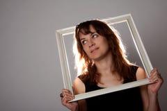 Retrato da mulher com frame Fotografia de Stock Royalty Free