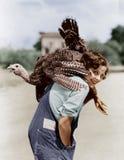 Retrato da mulher com o peru vivo lançado sobre o ombro (todas as pessoas descritas não estão vivendo mais por muito tempo e nenh fotografia de stock royalty free