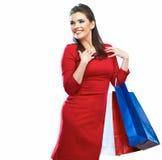 Retrato da mulher da compra isolado Sacos de compras backgrou branco Foto de Stock