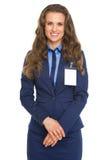 Retrato da mulher de negócio de sorriso com emblema foto de stock royalty free