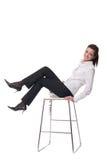 Retrato da mulher de negócio emocional na cadeira Imagem de Stock Royalty Free