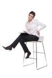 Retrato da mulher de negócio emocional na cadeira Fotografia de Stock Royalty Free