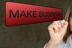 Retrato da mulher de negócios que aponta negócios do at'Make Imagem de Stock