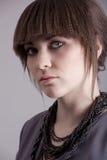 Retrato da mulher no cinza Foto de Stock Royalty Free