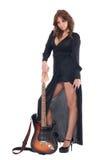 Retrato da mulher no vestido preto com guitarra Fotografia de Stock Royalty Free