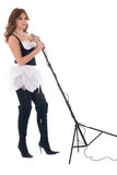 Retrato da mulher no vestido preto com microfone Imagens de Stock