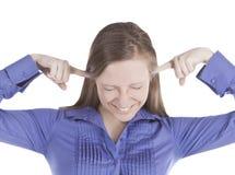 Retrato da mulher nova com os dedos nas orelhas imagem de stock royalty free
