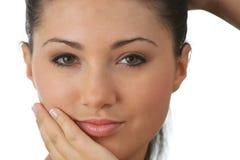 Retrato da mulher nova com pele da saúde da face Foto de Stock Royalty Free