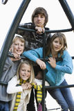 Retrato das crianças no equipamento do campo de jogos Fotografia de Stock Royalty Free