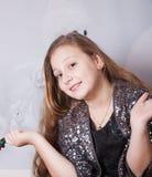 Retrato de 10 años de la Navidad de la muchacha Fotografía de archivo