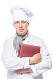 Retrato de 30 años del cocinero con los menús a disposición aislados Imagen de archivo