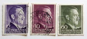 Retrato de Adolf Hitler en la Segunda Guerra Mundial de tres alemanes Imágenes de archivo libres de regalías